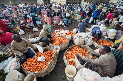 selling carrots in Wangige Market, Nairobi, Kenya